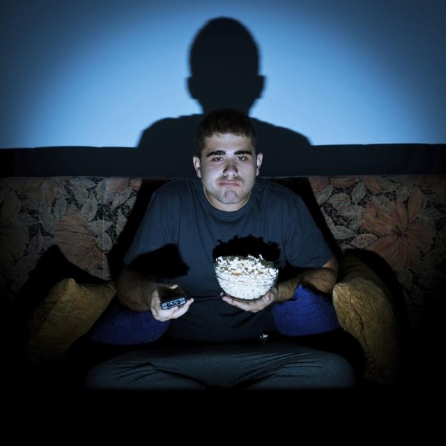 man-watching-tv-bored-eating